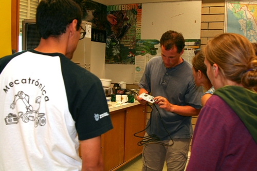 Photo of Renewable Energy Technology instructor Adam James demonstrating an equipment installation for students