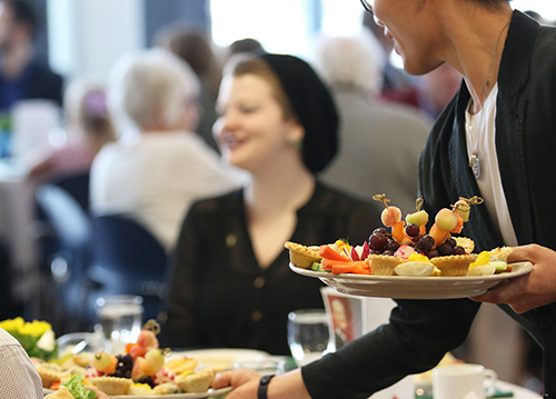The annual Bursary Tea held at Selkirk College brings donors and students together over fare prepared by the Professional Cook Training Program and served by students in the Resort and Hotel Management Program.