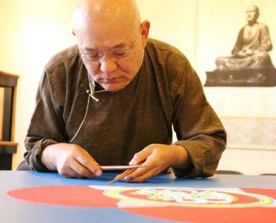 lama losang samten working on peace mandala