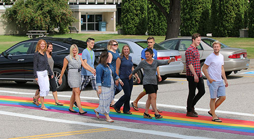 Crossing the street on the Castlegar Campus just got a little brighter as a rainbow of support for LGBTQ students at Selkirk College was recently painted on the crosswalk.