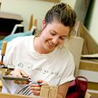 student working in the fine woodworking shop