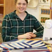 Student Rebekah Krahn dyed the fabrics pictured and made them into a quilt.