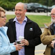 Kootenay West MLA Katrine Conroy (left) was joined by leader of the leader of the BC NDP John Horgan who stopped by the Saturday festivies. — with Katrine Conroy and John Horgan.