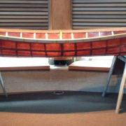 The finished sturgeon nose canoe on display in The Gathering Place on the Castlegar Campus.