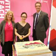 Student Nicole Laface (middle) had the honour of cutting the cake with Board of Governors chair Sharel Wallace (left) and President Angus Graeme by her side.