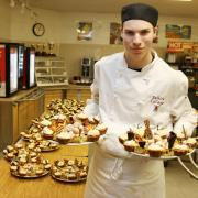 Professional Cook Program student Will Tucker stands with some of the amazing desert trays he and his fellow first year students prepared for the afternoon.