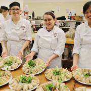 Professional Cook Program students with the plates of sandwiches they helped prepare.