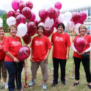 The Team 50 crew that prepared for the day by filling balloons in front of the Castlegar Campus.