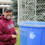 School of Business at Selkirk College Instructor Stephen Harris prepares the dunk tank, which was a popular feature at the community celebration.