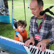 Selkirk College Contemporary Music and Technology Program Instructor Don Macdonald gets a little help from a friend.