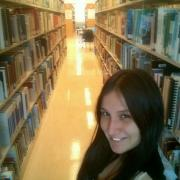 "Photo by Wendy Castellanos, Geographic Information Systems Student ""Finding Books Library for my Research"""