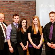First Place Business Competition: Judge Ron Anderson, Evan Richtsfeld, Brielle Hwalstad, Sam Thor-Larsen, Todd Hoodicoff