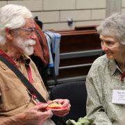 Dr. Mark Mealing (left) arrived to Selkirk College to teach Anthropology in 1970 and retired in 1999. He is seen here in discussion with former Librarian Sue Port.