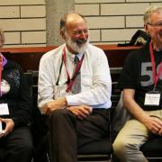 Former instructors Dr. Peter Wood (middle) and Craig Andrews (right) share a laugh with Ann Wood (left).