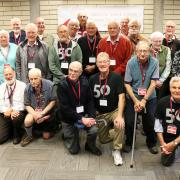 After three hours of discussion on the Castlegar Campus on Saturday afternoon, the pioneer faculty who were in attendance gathered for a group photo.