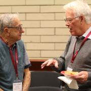 Jim Cromwell (right) chats with Jack Yolland who taught in the School of Business at Selkirk College between 1968 and 1987.
