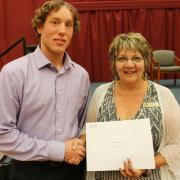 Arie Postmus received the Selkirk Saints Spirit Award from donor Joleen Kinakin.
