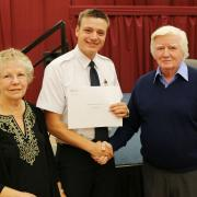 Aviation student Kyle McFarlane recieved the Curtis McDonell Memorial Scholarship from Murray and Donna McDonell.