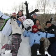 Buiding a snowman with friends