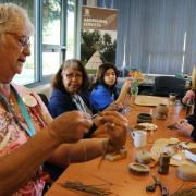 Elder Joanie Holmes in action during her basket making workshop.
