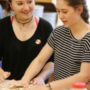 Cranbrook Grade Nine students Darcy Luke (left) and Kira Thompson during the bannock making workshop.