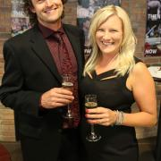 Selkirk College Marketing Manager Maggie Keczan (right) and her partner Matt Sumner enjoy a glass of champagne.