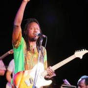 The Mighty Popo is a Juno Award winning world music artist who grew up in Rwanda and came to Canada as a refugee.