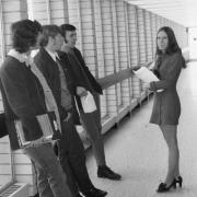 Students Gred Tegart, John Dunn and Walter Maluta talking to secretary, Grace Collins, 1972.