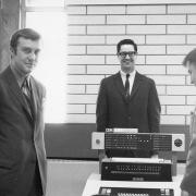 R.B. Wolf, Computer Manager and 2 IBM reps receiving new computer system, 1972.