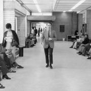 Selkirk College's front entrance with geography instructor, J Cromwell, 1972.