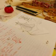 Journal illustrations, exploration and explanations for a final piece. In the background sewing and tailoring tools.