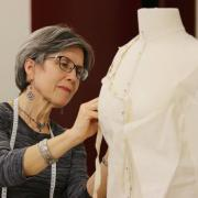 Student Karen Edwards creates a pattern on the mannequin for her final piece.